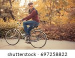 young handsome man riding... | Shutterstock . vector #697258822