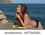 the young girl on the seashore | Shutterstock . vector #697265062