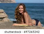 the smiling girl lies on the... | Shutterstock . vector #697265242