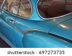back side of a blue vintage car  | Shutterstock . vector #697273735