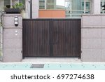 wooden gate and fence house. | Shutterstock . vector #697274638