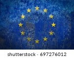 europe flag painted on a wall | Shutterstock . vector #697276012