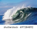 a huge wave breaks in the ocean ...   Shutterstock . vector #697284892
