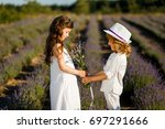 a brother giving lavender... | Shutterstock . vector #697291666
