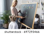 young mother explaining... | Shutterstock . vector #697293466