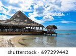 thatched roof cafe on boca... | Shutterstock . vector #697299442