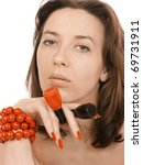 girl in a red beads holds nail... | Shutterstock . vector #69731911