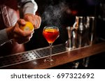 bartender is adding lemon zest... | Shutterstock . vector #697322692