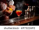 bartender is adding lemon zest... | Shutterstock . vector #697322692