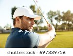 close up of a young male golfer ... | Shutterstock . vector #697339756