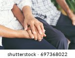 elderly couples are holding... | Shutterstock . vector #697368022