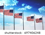 row of american flags blowing... | Shutterstock . vector #697406248