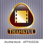 gold badge with film icon and...   Shutterstock .eps vector #697410226
