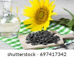 sunflower seeds and oil | Shutterstock . vector #697417342