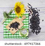 sunflower seeds and oil | Shutterstock . vector #697417366