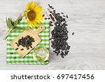 sunflower seeds and oil | Shutterstock . vector #697417456