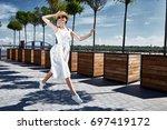 beautiful young sexy brunette... | Shutterstock . vector #697419172