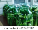 conservation of green cucumbers ... | Shutterstock . vector #697437706