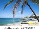 george town coastline on grand... | Shutterstock . vector #697454092