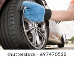 man cleaning dirty alloy wheel... | Shutterstock . vector #697470532