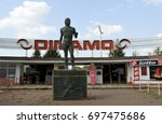 Small photo of BUCHAREST, ROMANIA - 8 AUGUST 2017: Entrance to sports park and Dinamo Bucuresti football stadium. A multi-sport club, the statue honours Ivan Patzaichin, canoeist, winner of 7 medals at 5 Olympics.