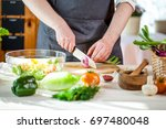 chef cutting fresh and... | Shutterstock . vector #697480048