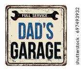dad's garage  full service... | Shutterstock .eps vector #697493932