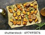 oven baked pumpkin slices with...   Shutterstock . vector #697495876