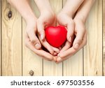 hands on heart | Shutterstock . vector #697503556