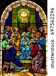 Small photo of NEW TRIER, MN - August 16, 2017: Stained glass window in Church of St. Mary, depicting Pentecost, the coming of the Holy Spirit on Mary and the apostle