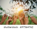 children show hand with light... | Shutterstock . vector #697564762