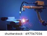 industrial welding robots in... | Shutterstock . vector #697567036