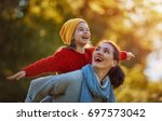 happy family on autumn walk ... | Shutterstock . vector #697573042
