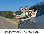 happy brother and his two... | Shutterstock . vector #697594582