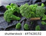 metal basket with fresh green... | Shutterstock . vector #697628152