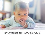 cute baby is crawling on the... | Shutterstock . vector #697637278