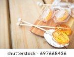 honey caramel candy lollipop on ... | Shutterstock . vector #697668436