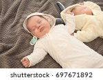 cute little babies sleeping on... | Shutterstock . vector #697671892