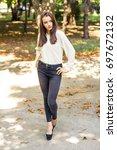 the girl is walking in the park   Shutterstock . vector #697672132
