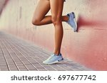 close up  tans woman's legs in...   Shutterstock . vector #697677742