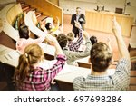 rear view of students raising... | Shutterstock . vector #697698286