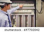 control room engineer. power... | Shutterstock . vector #697702042