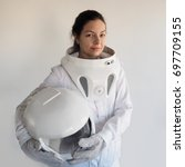 female astronaut on a white... | Shutterstock . vector #697709155