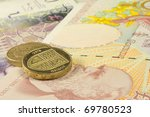 uk currency showing pound coins and notes - stock photo