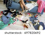 girl can't decide what to wear | Shutterstock . vector #697820692
