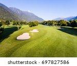 golf course   green grass and... | Shutterstock . vector #697827586