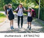 happy school children in... | Shutterstock . vector #697842742