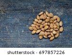 heap of tasty almonds nuts on... | Shutterstock . vector #697857226