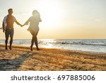 summer time on beach and two... | Shutterstock . vector #697885006
