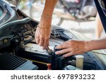 engine engineer is replacing ... | Shutterstock . vector #697893232